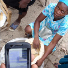 mobile phone in use during food distribution in Haiti