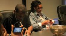 Youth from Youth Radio Mobile Action Lab work on apps