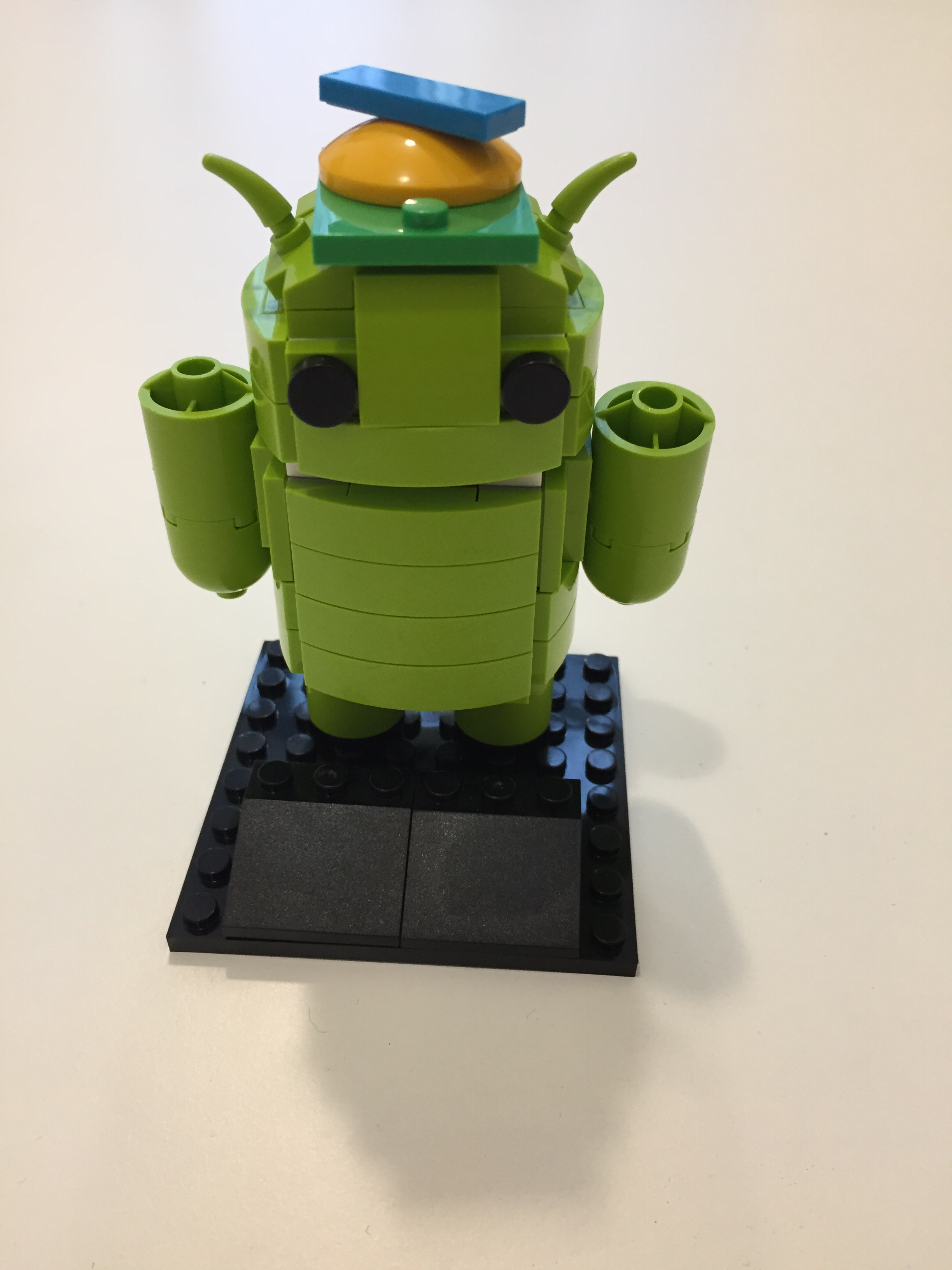 Android robot assembled from blocks