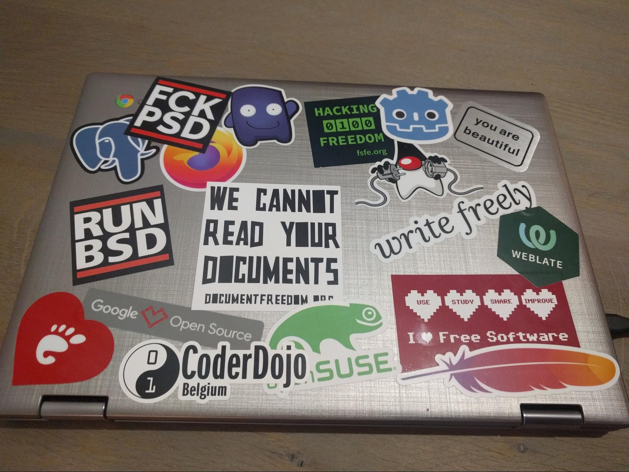 A laptop with many stickers